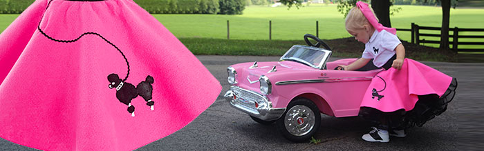 toddler playing with replica 50's car wearing a pink poodle skirt